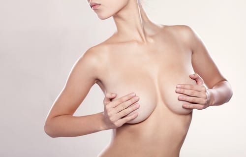 Topless Woman Holding Breasts