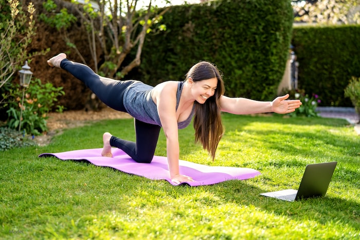 Woman exercising outside to maintain her body contouring results.